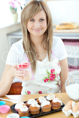 Caucasian woman cooking cakes in the kitchen