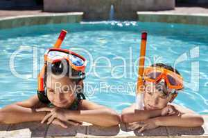 Boy and Girl In Swimming Pool with Goggles & Snorkel