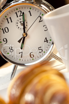Alarm Clock and Continental Breakfast of Croissant & Coffee