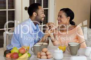Happy African American Couple Holding Hands At Healthy Breakfast
