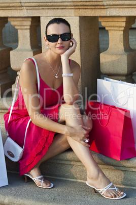 Beautiful Latina Hispanic Woman Sitting With Shopping Bags