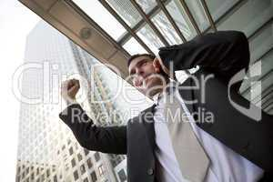 Happy Businessman Celebrating On Cell Phone In The City