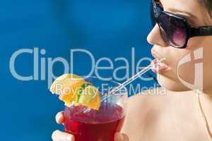 Beautiful Hispanic Latina Woman Drinking A Red Cocktail