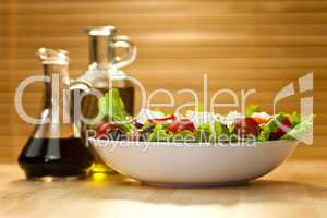 Salad With Olives, Cheese, Olive Oil and Balsamic Vinegar Dressi