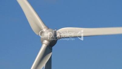 Wind power turbine on blue sky