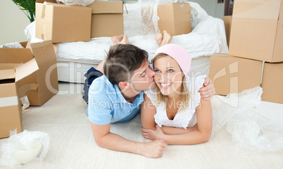 Enamored couple relaxing after moving