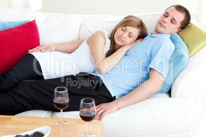 Loving couple sleeping lying on a sofa