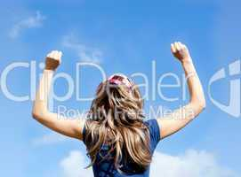 Portrait of a  blond woman punching the air
