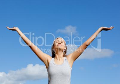 Beautiful woman relaxing against blue sky