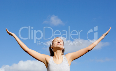 Radiant woman relaxing against blue sky