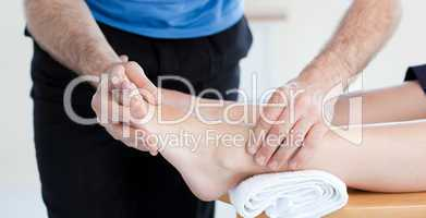 Close-up of a Caucasian physical therapist giving a foot massage