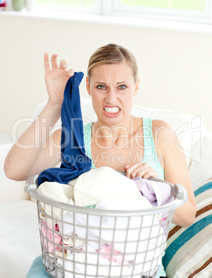 Disgusted woman doing her laundry