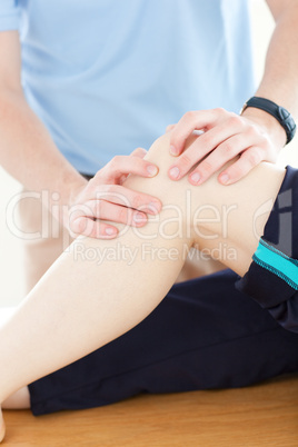 Close-up of a physical therapist giving a knee massage