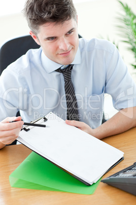 Confident businessman showing a contract to a customer