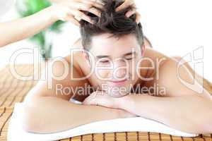Relaxed man receiving a head massage