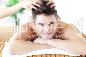 Young man receiving a head massage
