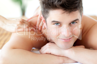 Beautiful man enjoying a back massage