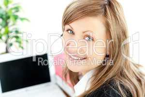 Beautiful businesswoman with headset on smiling at the camera