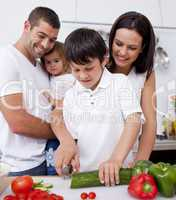 Jolly family cooking together