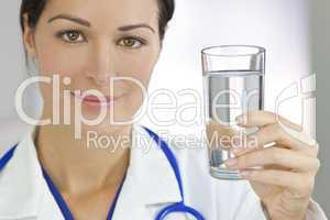 Smiling Woman Doctor in Hospital Holding Glass of Water