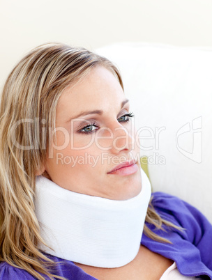 Unhappy woman with a neck brace