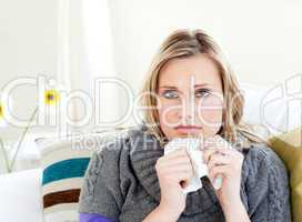 Unhealthy woman sitting on a sofa