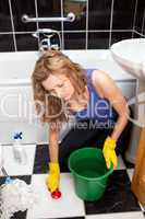 Unhappy woman cleaning the ground