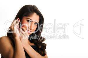 Beautiful girl speaking in telephone, using a headset
