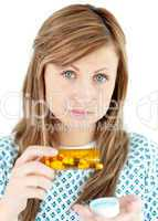 Diseased woman taking pills
