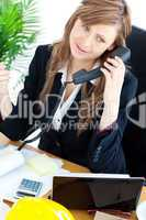 Portrait of a busy businesswoman talking on phone