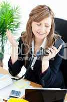 Assertive businesswoman on phone