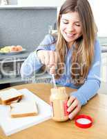 Glowing woman woman eating peanut butter