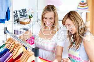 Two Caucasian women are doing shopping