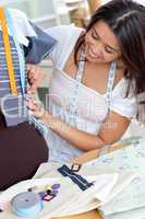 Glad young woman working in a store