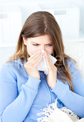 Sick woman sitting at home in her bed