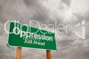 Oppression Green Road Sign Over Storm Clouds