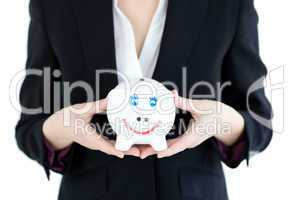 Close-up of a businesswoman holding a piggybank