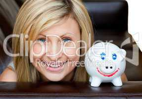 Portrait of a handsome woman with a piggybank