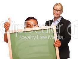 Hispanic Boy Holding Chalk Board and Female Teacher Behind