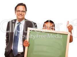 Hispanic Boy Holding Chalk Board with Male Teacher Behind
