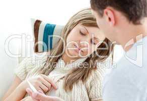 Sad woman with boyfriend holding a pill
