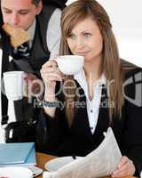 Beautiful businesswomand drinking  coffee while her husband hurr
