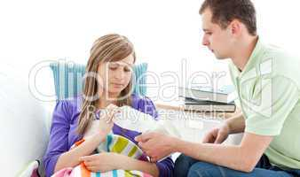 Young man with tissues and his sick girlfriend