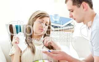 Beautiful sick woman getting pills from her boyfriend