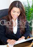 Confident businesswoman with a laptop smiling