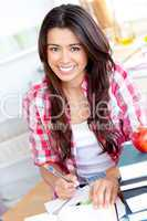 Portrait of a smiling  caucasian teen girl studying