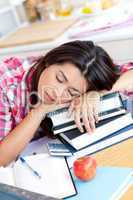 Close-up of a tired caucasian teen girl studying