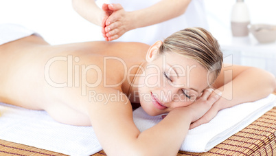 Attractive woman having a massage with massage oil