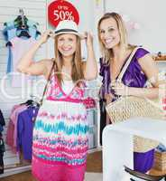 Relaxed women choosing clothes together