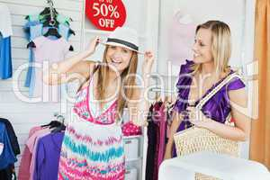 Jolly women choosing clothes together